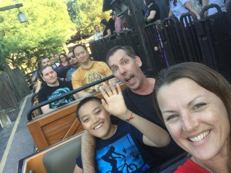 Family ridding a roller coaster