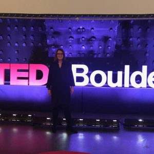 kate nicholson in front of TEDxBoulder sign