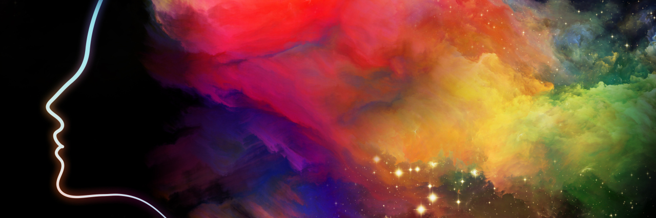 abstract outline of woman's head with colorful clouds around it