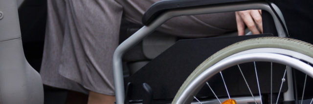 Wheelchair user getting ready to drive.