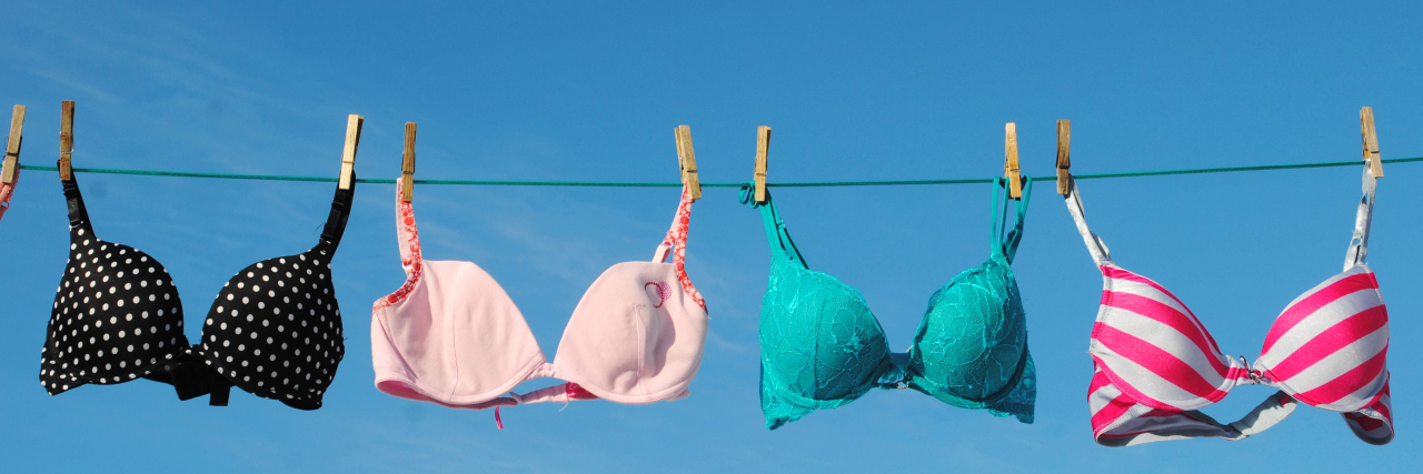 Four colorful Bras on Clothesline