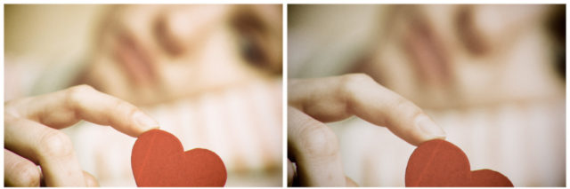 Sad girl holding heart symbol by her finger.
