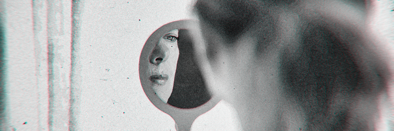 Woman looking into a mirror, blurred black-and-white image.