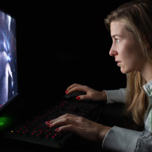 woman playing video games on her computer