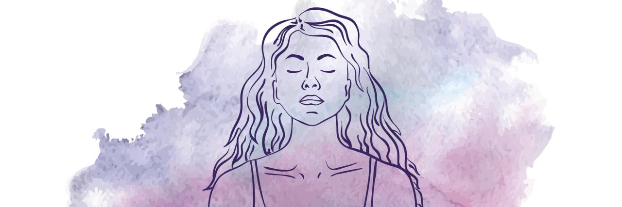Woman sitting in the lotus yoga pose