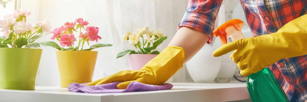 woman cleaning a table in her home