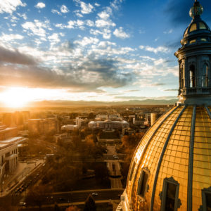 beautiful drone image of the golden cupola of the Colorado state capital building in the city of Denver