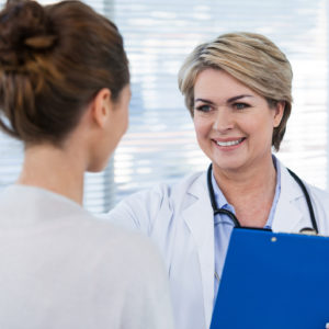 doctor speaking with patient at the hospital