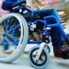 Wheelchair in motion in shopping center.