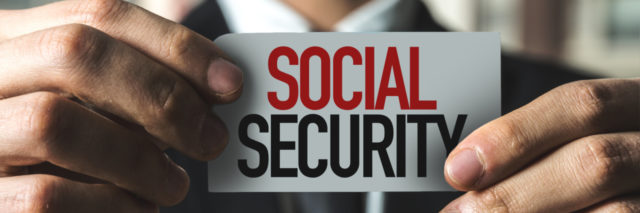Man holding up Social Security sign.