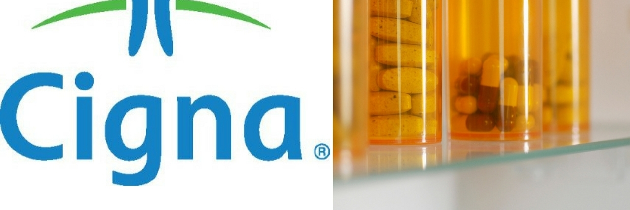 cigna logo and bottles of pills
