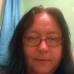 woman wearing glasses and no makeup
