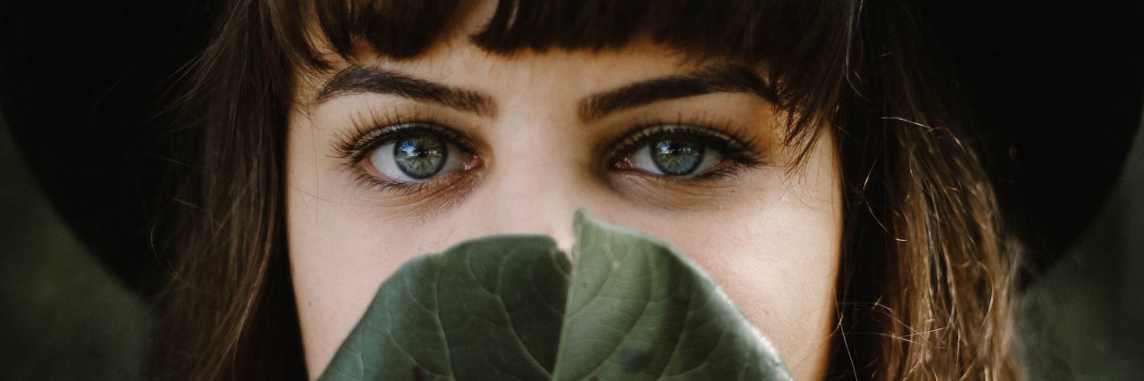 woman face behind leaf