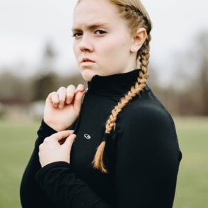 girl with braids looking angry