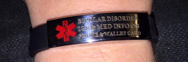 bipolar disorder medical bracelet on person's arm