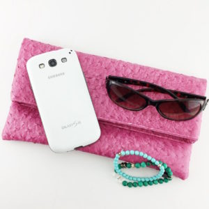 colorful bag with sunglasses and phone
