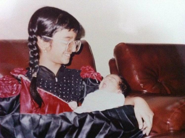 girl holding her baby sister