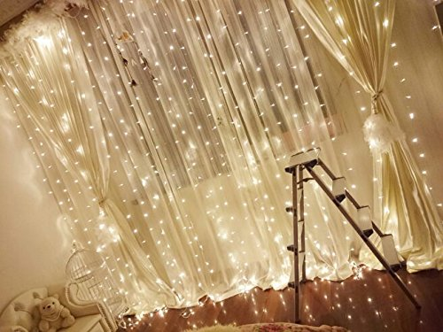 fairy lights hanging in bedroom window