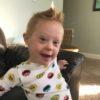 """Little boy wearing """"sesame Street"""" pajamas"""