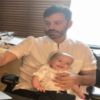 Jimmy Kimmel sitting with son Billy