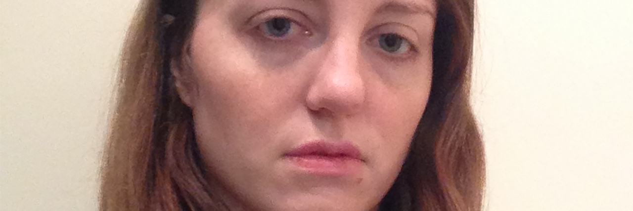 #metoo woman looking upset at camera after crying panic attack