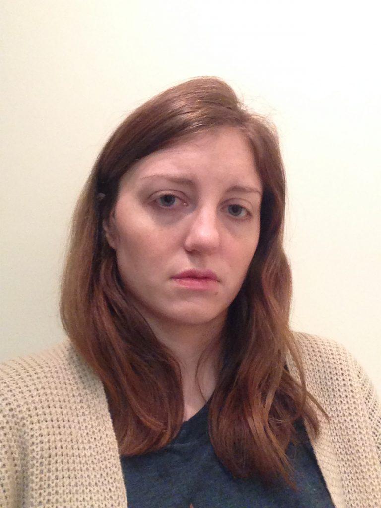 woman looking upset at camera after crying panic attack