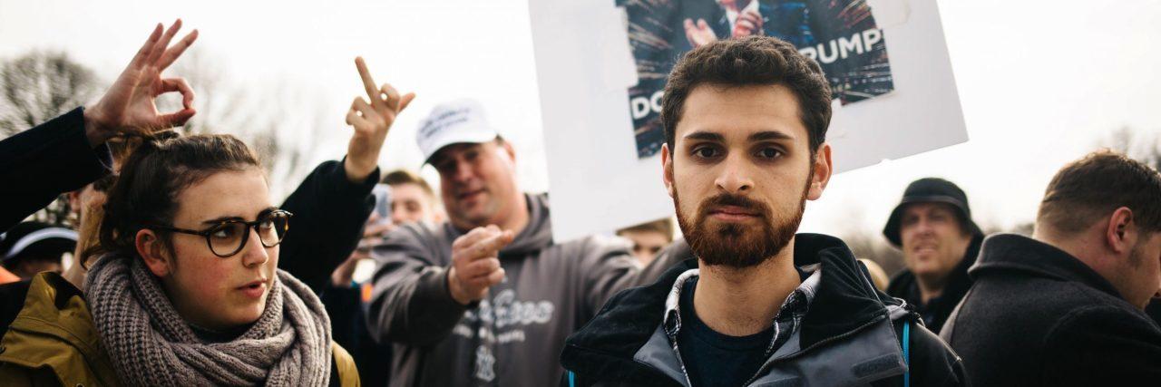 male protestor at donald trump inauguration looking at camera