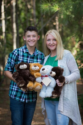 Luke and his mom holding 4 prayer bears