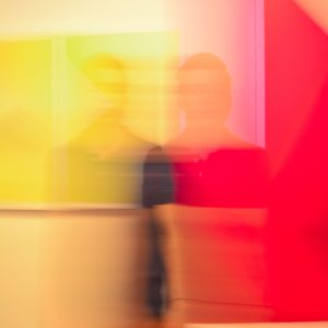 double exposure of man with color blocks behind him