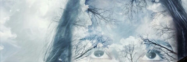 double exposure of a woman's face and a blue cloudy sky