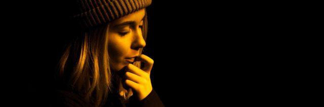 upset worried woman in darkness