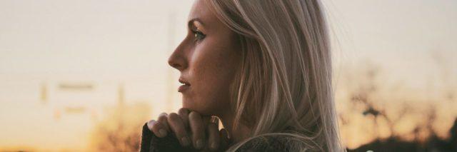 woman looking hopeful at sunrise