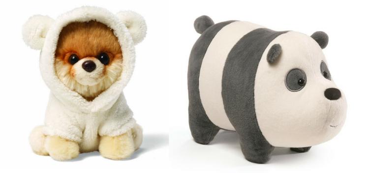 dog wearing a bear suit stuffed animal and a panda stuffed animal