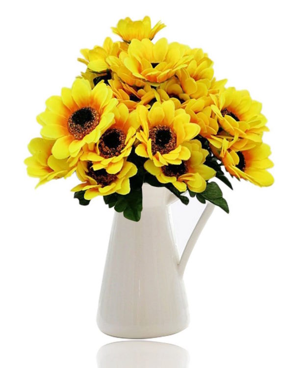 sunflowers in a white handled vase