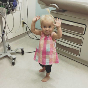 young child dancing in doctor's office