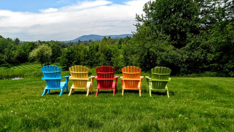 colorful chairs in a field in maine