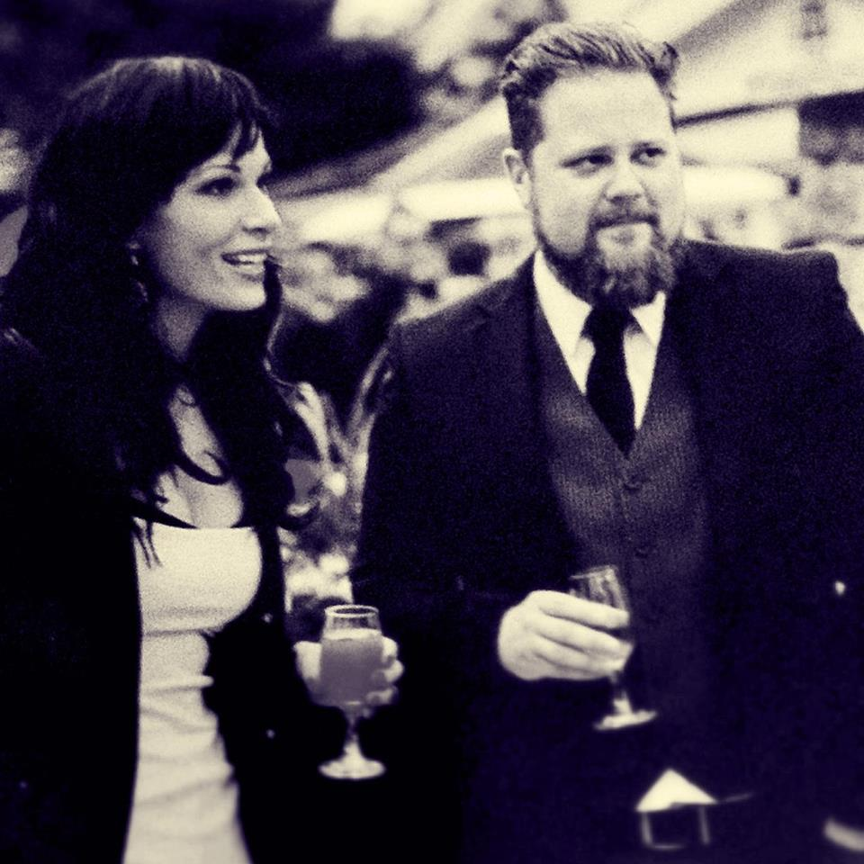 The writer and her partner at a wedding.