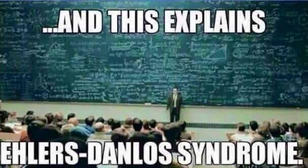 large chalkboard filled with writing and text that says '...and this explains ehlers-danlos syndrome'