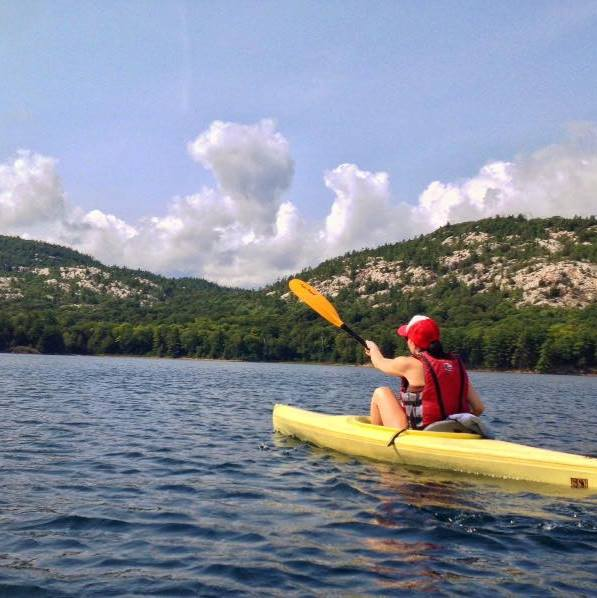 The writer kayaking.