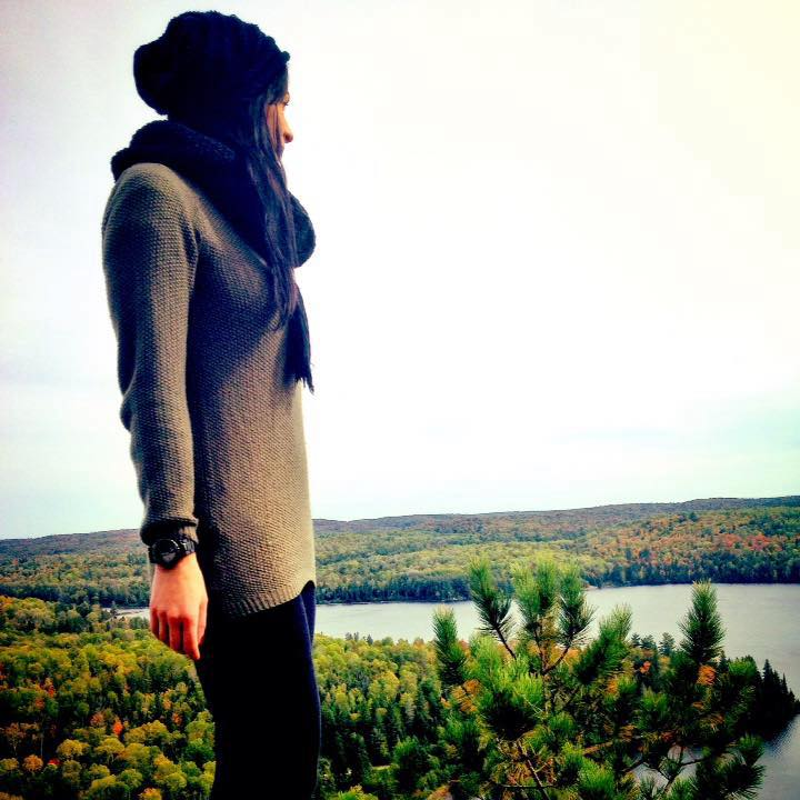 The writer looking at a view after a hike.