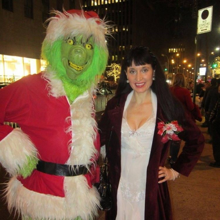woman posing with the grinch