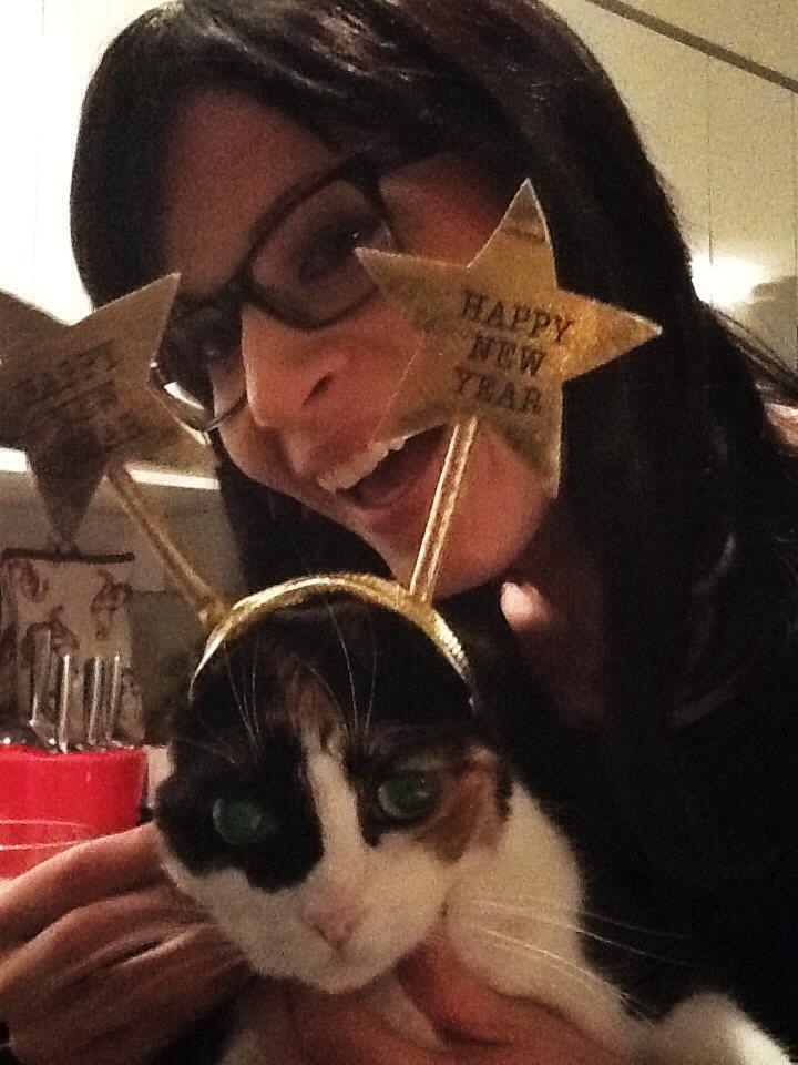 The writer and her cat, the cat wearing a New Year's Day headband.