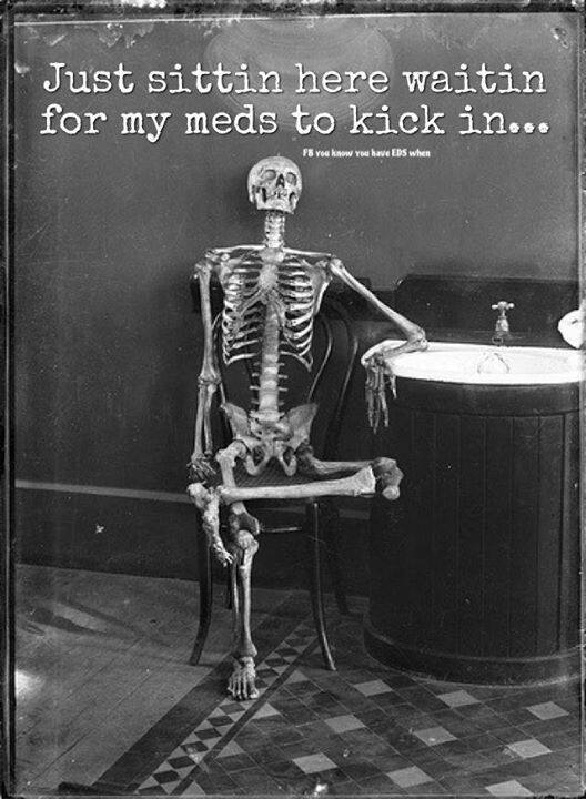 meme of skeleton sitting at table with text waiting for my pain meds to kick in