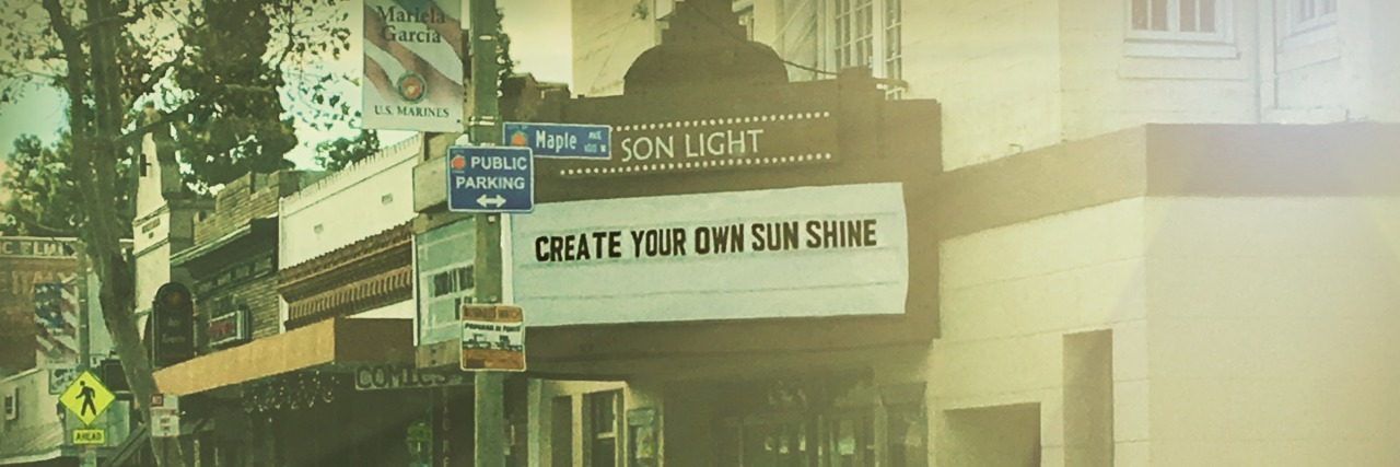 theater marquee that says create your own sunshine