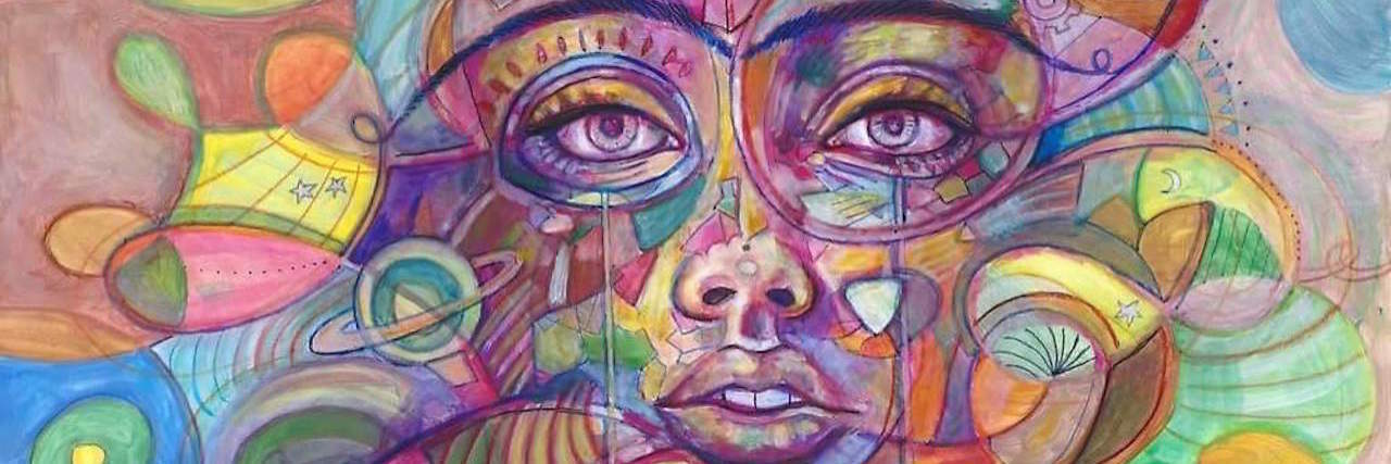 A colorful illustration of a woman's face.