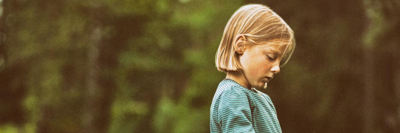 Girl walking along rural road.