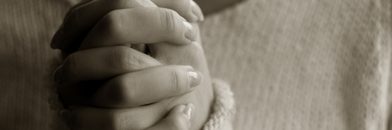 Praying woman hands AA monochrome