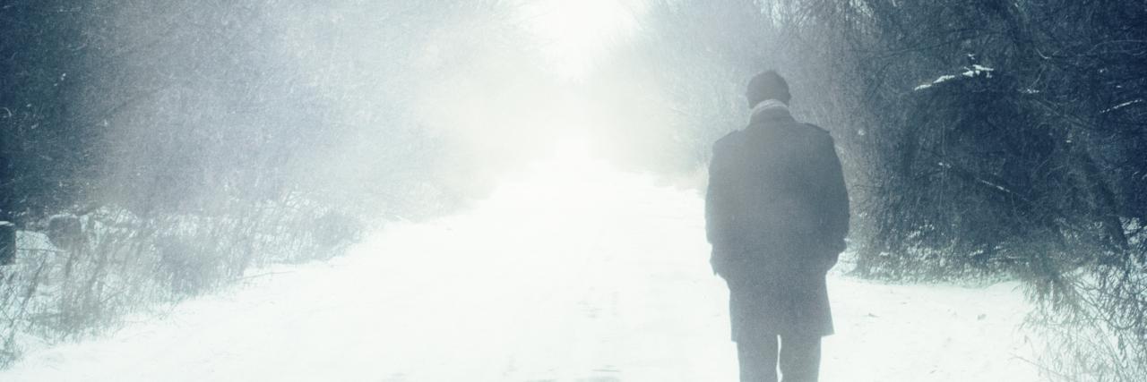 man walks alone in winter