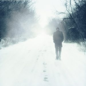 man walks alone in winter
