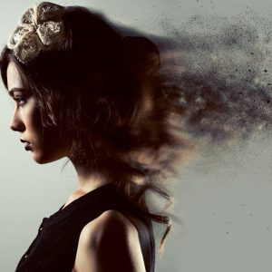 profile of young woman with cloudy digital effects on hair and back of head